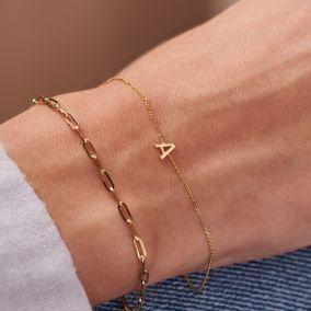 model wearing 9ct gold initial bracelet