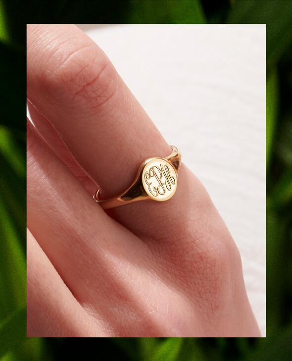 model wearing 9ct gold monogrammed signet ring