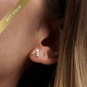 Model wearing 9ct gold letter A stud earrings