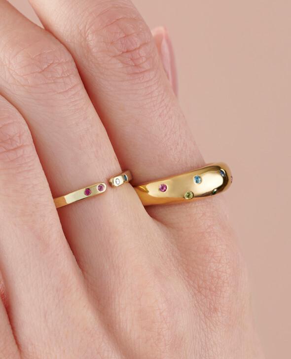 Model wearing two birthstone rings