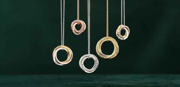 Hanging Russian Ring Necklaces on Dark Green Velvet