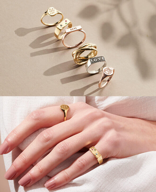 Model wearing signet rings