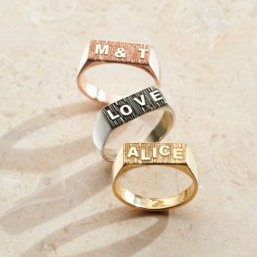 three textured personalised signet rings lined up