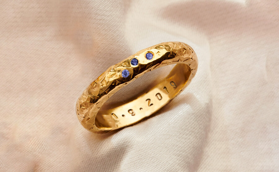 textured gold personalised ring set with tanzanite birthstones