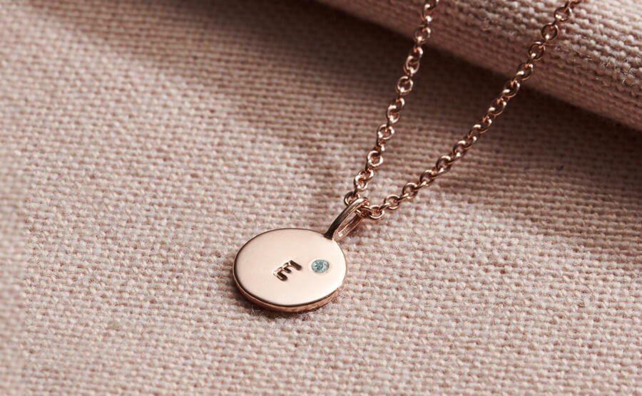 small initial disc set with Alexandrite birthstone