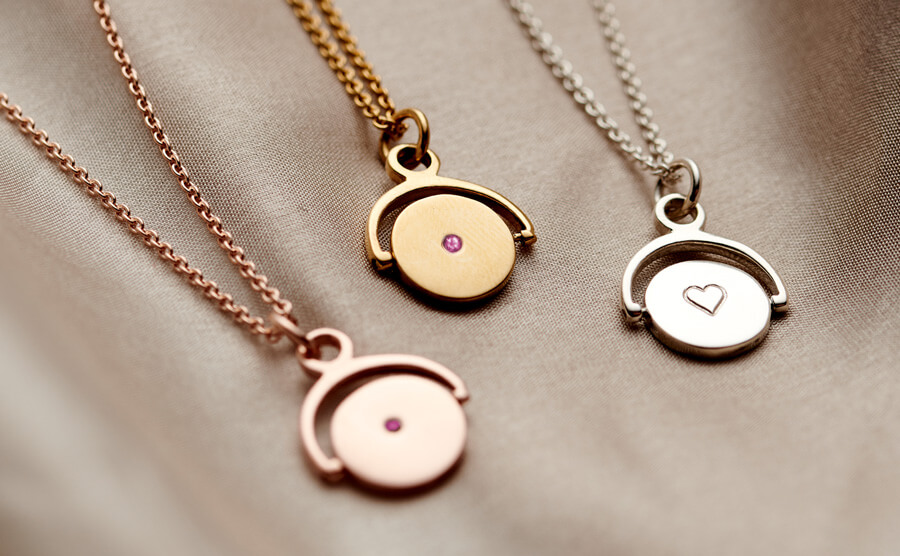 spinner necklace pendants with pink tourmaline birthstones