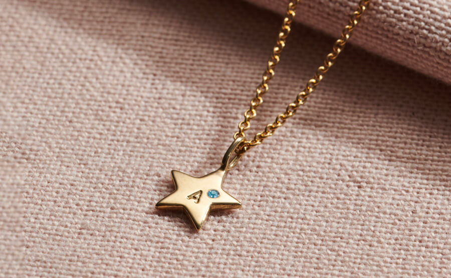silver star personalised with initial and Aquamarine birthstone