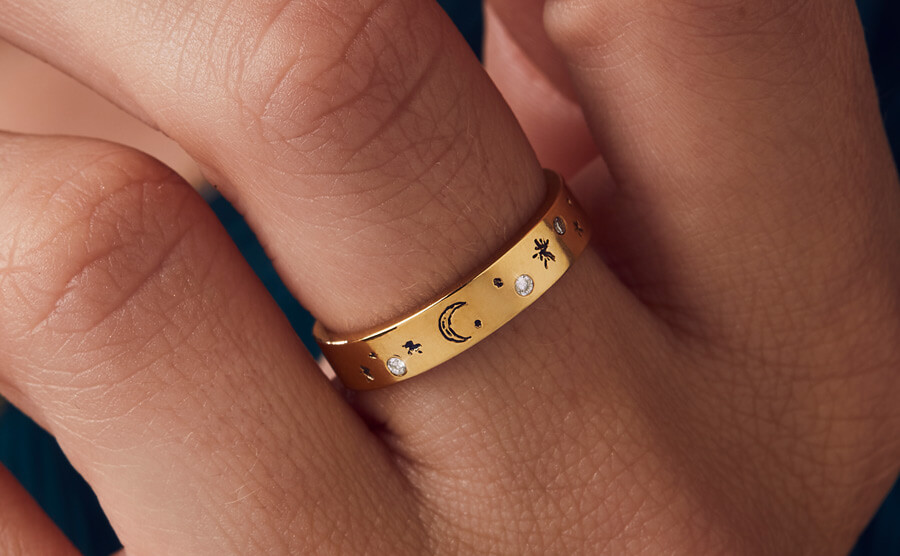 gold ring set with multiple diamonds