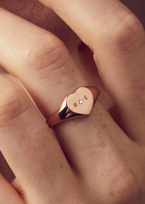 model wearing diamond signet ring