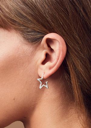 model wearing star hoop earrings