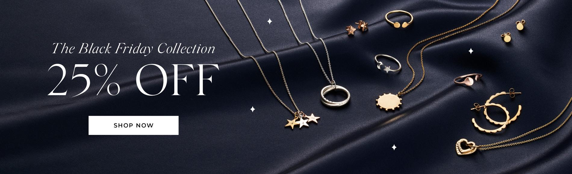 display of personalised jewellery on navy silk