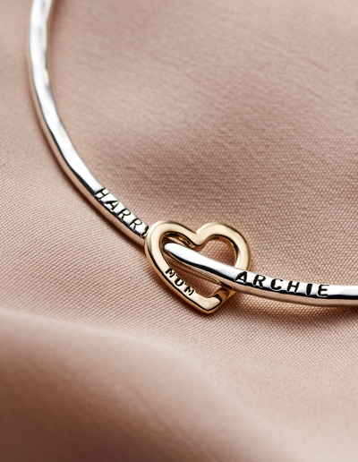 personalised silver bangle on wrist