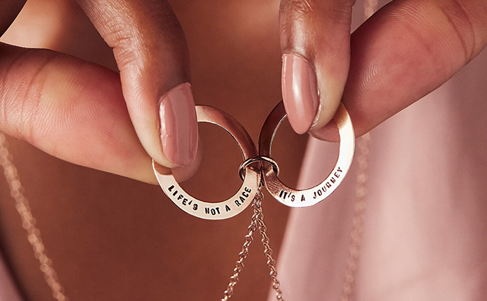 Two personalised flat hoops on a silver chain