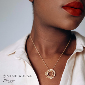 Mimilabesa wearing a personalised necklace