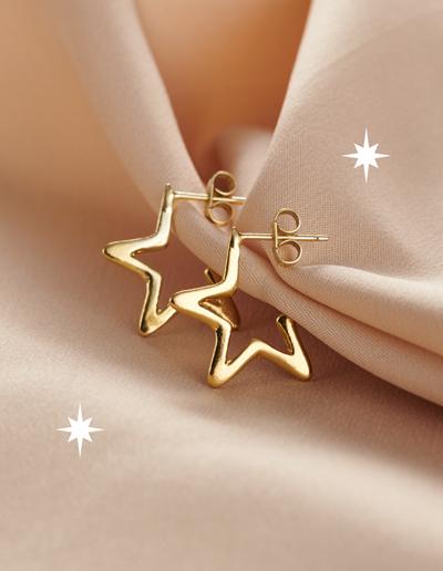 9ct gold star hoop earrings on pink background