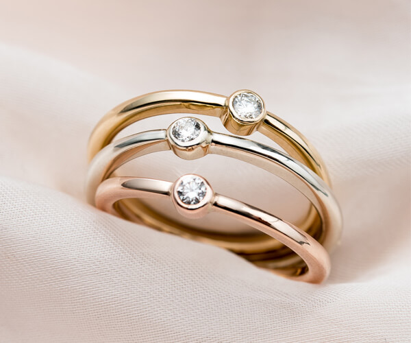 Three gold diamond engagement rings