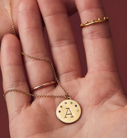 Gold personalised disc necklace with birthstones