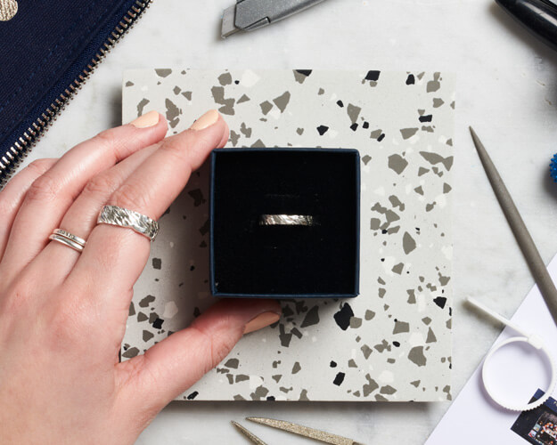 Silver cast Ring in a box