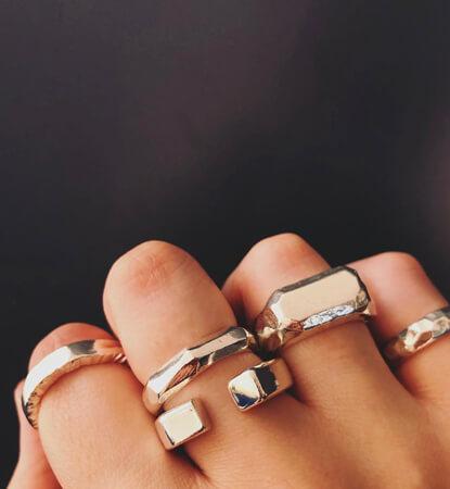 Hand wearing handmade silver rings